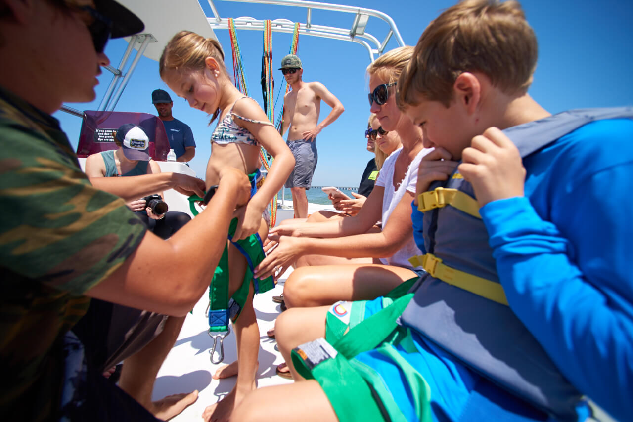 Family on a boat preparing to parasail