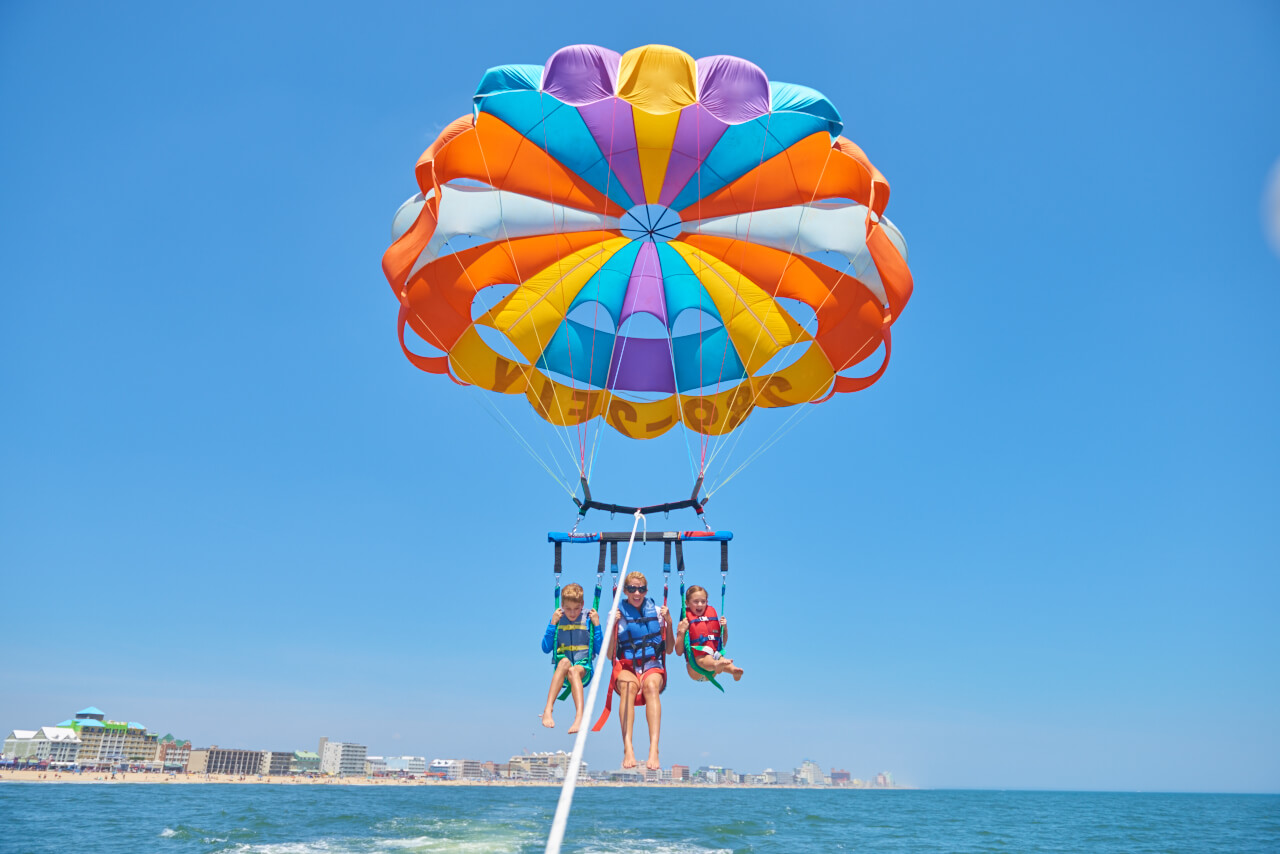 Family ascending on a parasail